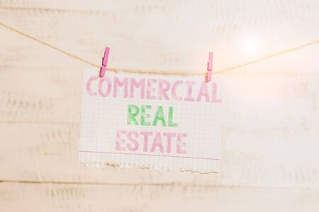 Writing note showing Commercial Real Estate. Business concept for Income Property Building or Land for Business Purpose Clothesline clothespin rectangle shaped paper reminder white wood desk