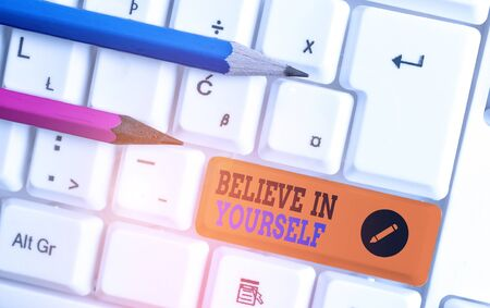 Conceptual hand writing showing Believe In Yourself. Concept meaning common piece of advice that you can do everything White pc keyboard with note paper above the white background