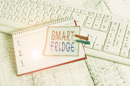 Conceptual hand writing showing Smart Fridge. Concept meaning programmed to sense what kinds of products being stored inside notebook reminder clothespin with pinned sheet light wooden