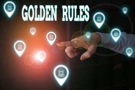 Writing note showing Golden Rules. Business concept for basic principle that should always follow to ensure success Woman wear formal work suit presenting presentation using smart device