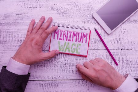 Conceptual hand writing showing Minimum Wage. Concept meaning the lowest wage permitted by law or by a special agreement