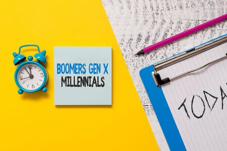 Writing note showing Boomers Gen X Millennials. Business concept for generally considered to be about thirty years Notepad clipboard colored paper sheet alarm clock wooden background Stok Fotoğraf