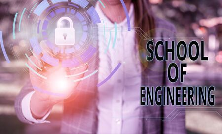 Handwriting text School Of Engineering. Conceptual photo college to study mechanical communication subjects Female human wear formal work suit presenting presentation use smart device