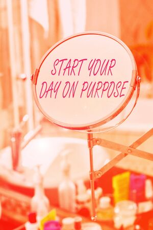 Handwriting text Start Your Day On Purpose. Conceptual photo Have clean ideas of what you are going to do Round shape mirror and toiletries placed next to sink in a modern bathroom Stok Fotoğraf