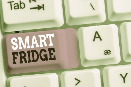 Handwriting text Smart Fridge. Conceptual photo programmed to sense what kinds of products being stored inside White pc keyboard with empty note paper above white background key copy space
