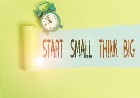 Conceptual hand writing showing Start Small Think Big. Concept meaning Initiate with few things have something great in mind Stok Fotoğraf