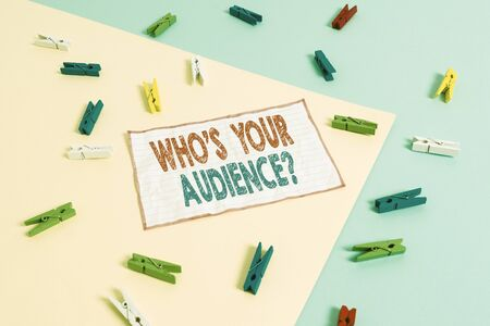 Conceptual hand writing showing Who S Your Audience Question. Concept meaning asking someone about listeners category Coaching Colored clothespin paper reminder with yellow blue background