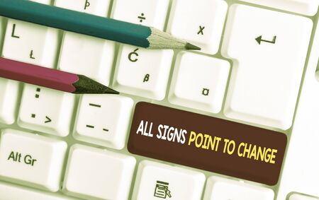 Conceptual hand writing showing All Signs Point To Change. Concept meaning Necessity of doing things differently new vision White pc keyboard with note paper above the white background Stock Photo