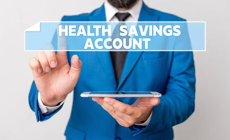 Handwriting text Health Savings Account. Conceptual photo users with High Deductible Health Insurance Policy Businessman with pointing finger in front of him Stock Photo