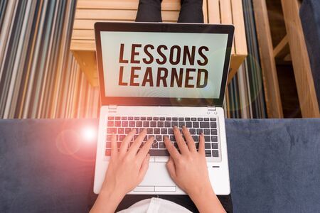 Writing note showing Lessons Learned. Business concept for the knowledge or understanding gained by experience woman laptop computer office supplies technological devices inside home