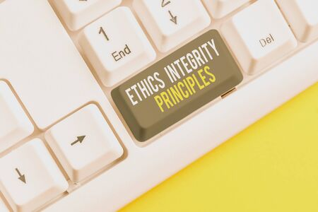 Conceptual hand writing showing Ethics Integrity Principles. Concept meaning quality of being honest and having strong moral White pc keyboard with note paper above the white background