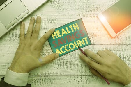 Writing note showing Health Savings Account. Business concept for users with High Deductible Health Insurance Policy Stock Photo