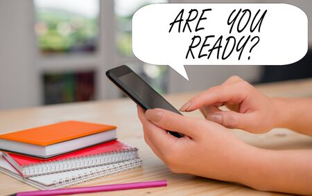 Conceptual hand writing showing Are You Ready Question. Concept meaning Setting oneself on the activity Being Prepared woman using smartphone and technological devices inside the home
