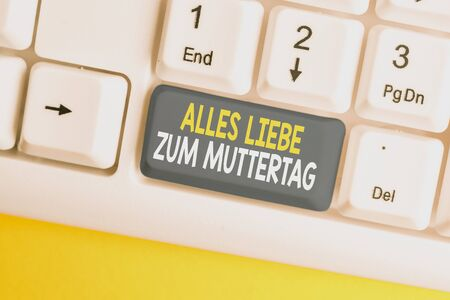 Conceptual hand writing showing Alles Liebe Zum Muttertag. Concept meaning Happy Mothers Day Love Good wishes Affection White pc keyboard with note paper above the white background Foto de archivo