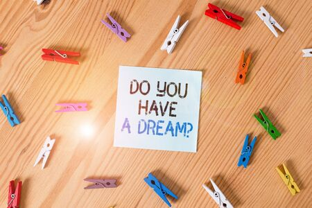Writing note showing Do You Have A Dream Question. Business concept for asking someone about life goals Achievements Colored clothespin papers empty reminder wooden floor background office