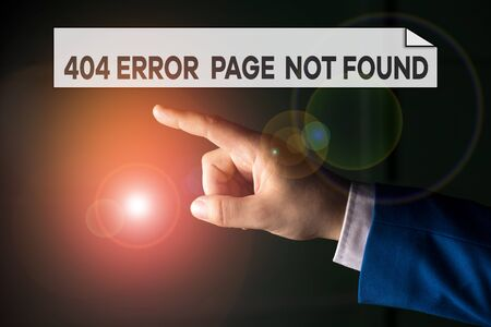 Writing note showing 404 Error Page Not Found. Business concept for Webpage on Server has been Removed or Moved Isolated hand pointing with finger. Business concept pointing finger 免版税图像