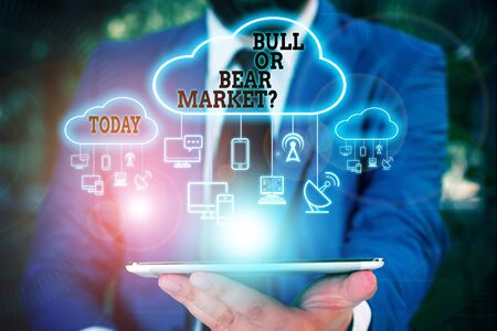 Text sign showing Bull Or Bear Market Question. Business photo text asking someone about his marketing method Male human wear formal work suit presenting presentation using smart device