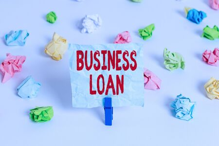 Handwriting text Business Loan. Conceptual photo Credit Mortgage Financial Assistance Cash Advances Debt Colored crumpled papers empty reminder white floor background clothespin Banco de Imagens - 131295197