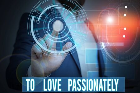 Handwriting text writing To Love Passionately. Conceptual photo Strong feeling for someone or something else Affection Male human wear formal work suit presenting presentation using smart device Stock fotó