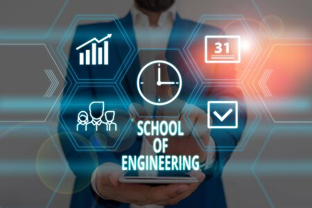 Text sign showing School Of Engineering. Business photo showcasing college to study mechanical communication subjects Male human wear formal work suit presenting presentation using smart device