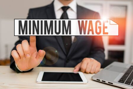 Text sign showing Minimum Wage. Business photo text the lowest wage permitted by law or by a special agreement