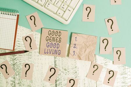 Handwriting text Good Genes Good Living. Conceptual photo Inherited Genetic results in Longevity Healthy Life Writing tools, computer stuff and math book sheet on top of wooden table 版權商用圖片