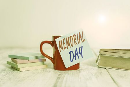 Text sign showing Memorial Day. Business photo text remembering the military demonstratingnel who died in service Coffee cup blank sticky note stacked note pads books retro old wooden table Imagens