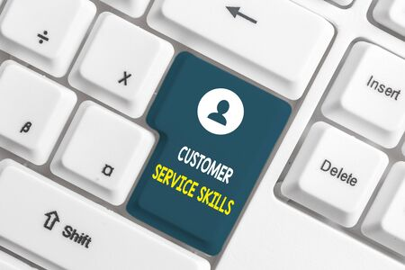 Text sign showing Customer Service Skills. Business photo showcasing Aptitude to master to improve dealings with client White pc keyboard with empty note paper above white background key copy space Imagens