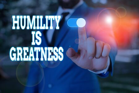 Text sign showing Humility Is Greatness. Business photo text being Humble is a Virtue not to Feel overly Superior Male human wear formal work suit presenting presentation using smart device