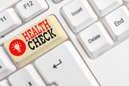 Word writing text Health Check. Business photo showcasing thorough physical examination A medical checkup of oneself White pc keyboard with empty note paper above white background key copy space