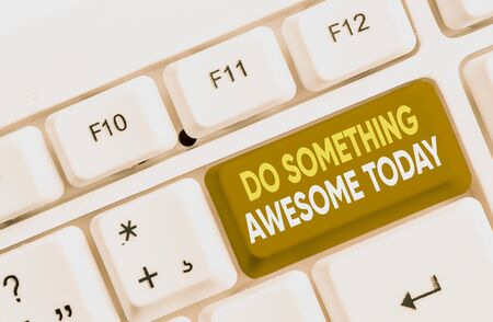 Writing note showing Do Something Awesome Today. Business concept for Make an incredible action motivate yourself White pc keyboard with note paper above the white background