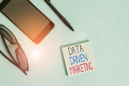 Handwriting text writing Data Driven Marketing. Conceptual photo Strategy built on Insights Analysis from interactions Eyeglasses colored sticky note smartphone cell pen cool pastel background