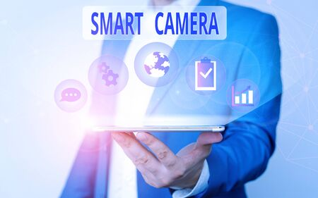 Handwriting text writing Smart Camera. Conceptual photo individual image processing systems designed to automate Male human wear formal work suit presenting presentation using smart device Stock Photo