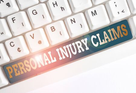Text sign showing Personal Injury Claims. Business photo text being hurt or injured inside work environment White pc keyboard with empty note paper above white background key copy space