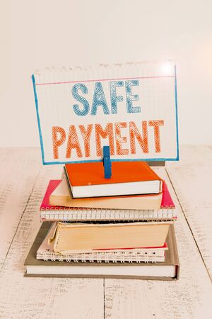 Text sign showing Safe Payment. Business photo text webpage where credit card numbers are entered is secured pile stacked books notebook pin clothespin colored reminder white wooden Banque d'images
