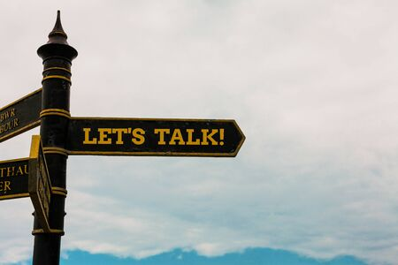 Conceptual hand writing showing Let S Talk. Concept meaning they are suggesting beginning conversation on specific topic Road sign on the crossroads with blue cloudy sky in the background Stock fotó
