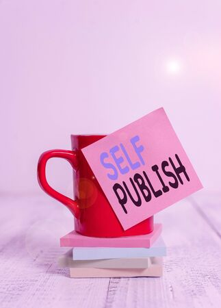 Handwriting text Self Publish. Conceptual photo published their work independently and at their own expense Coffee cup blank sticky note stacked note pads retro retro wooden table