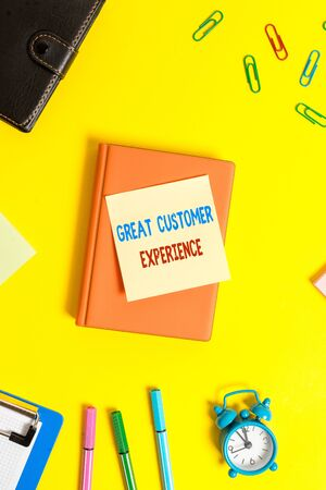 Word writing text Great Customer Experience. Business photo showcasing responding to clients with friendly helpful way Flat lay above table with copy space paper clips clock and pencils