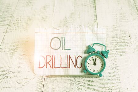 Writing note showing Oil Drilling. Business concept for involves the drilling and pumping of oil from underground wells