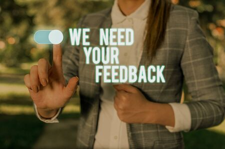 Text sign showing We Need Your Feedback. Business photo showcasing Give us your review thoughts comments what to improve Woman wear formal work suit presenting presentation using smart device