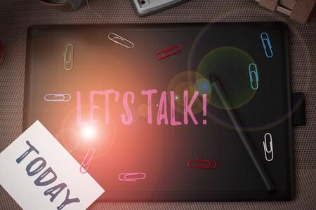 Conceptual hand writing showing Let S Talk. Concept meaning they are suggesting beginning conversation on specific topic Scissors and equipments math book above textured backdrop