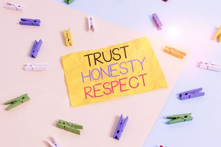 Handwriting text writing Trust Honesty Respect. Conceptual photo Respectable Traits a Facet of Good Moral Character Colored clothespin paper empty reminder yellow blue floor background office