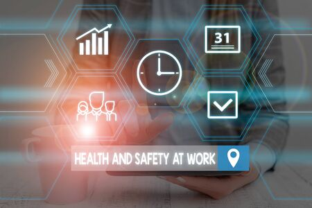 Word writing text Health And Safety At Work. Business photo showcasing Secure procedures prevent accidents avoid danger Woman wear formal work suit presenting presentation using smart device