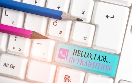Word writing text Hello I Am In Transition. Business photo showcasing Changing process Progressing planning new things White pc keyboard with empty note paper above white background key copy space