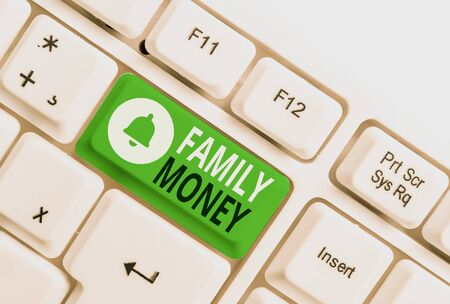 Conceptual hand writing showing Family Money. Concept meaning the inherited wealth of established upperclass families White pc keyboard with note paper above the white background