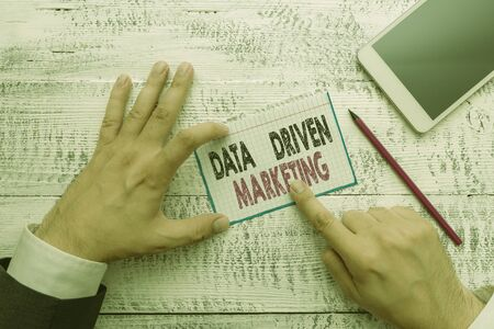 Writing note showing Data Driven Marketing. Business concept for Strategy built on Insights Analysis from interactions