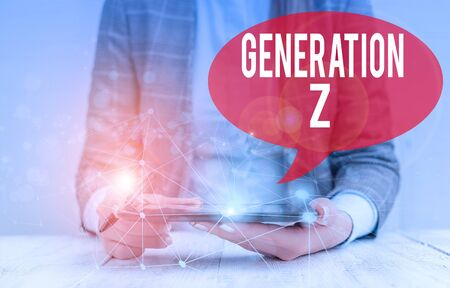 Writing note showing Generation Z. Business concept for name for the generation of children after the millennials Female human wear formal work suit presenting smart device
