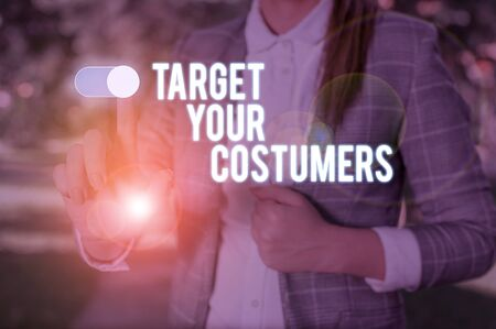 Text sign showing Target Your Costumers. Business photo showcasing Specific Range and Interest Potential Users and Buyers Woman wear formal work suit presenting presentation using smart device