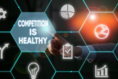 Writing note showing Competition Is Healthy. Business concept for Rivalry is good in any Venture leads to Improvement Male human wear formal suit presenting using smart device