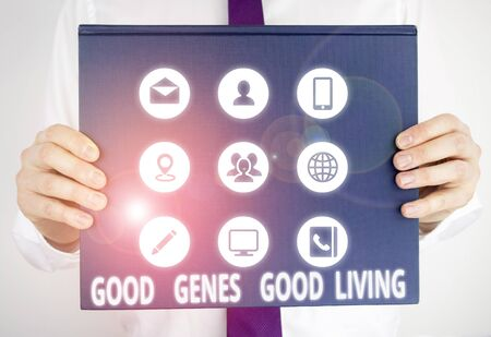 Handwriting text writing Good Genes Good Living. Conceptual photo Inherited Genetic results in Longevity Healthy Life Male human holding thick textured cardboard of business promotion concept 版權商用圖片